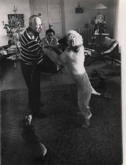 Pablo Picasso Playing with Dogs by Edward Quinn, 1960