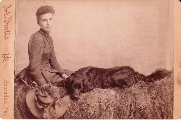 Lady-and-a-black-dog-vintage-cabinet-card-photograph