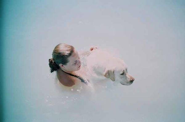 Dog-and-woman-swimming-michelle-gow