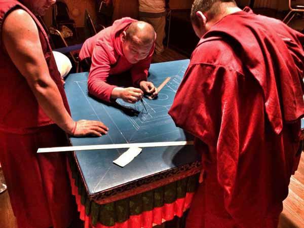 Gaden-shartse-buddhist-monks-in-grass-valley