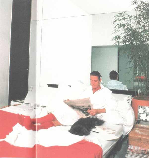 Halston-in-bed-with-pekingese-dog-linda