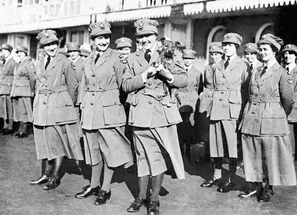 Womens-royal-air-force-with-dog-on-parade-1918